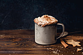 Hot chocolate with whipped cream, cinnamon and cookies