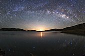 Milky Way over lake at moonrise