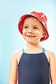 Girl wearing sunhat and suncream