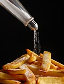 Salt pouring onto chips