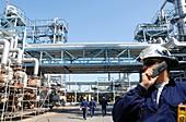 Workers inside refinery
