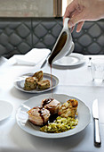 Pork fillet with pretzel napkin dumplings and braised pointed cabbage