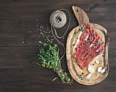 Cured pork meat with garlic, spices and thyme