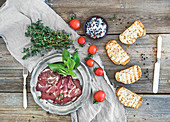 Smoked meat with fresh basil, cherry-tomatoes and bread