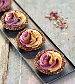 Raw vegan mini tartlets with colourful cream