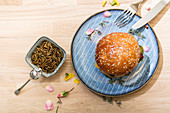 A mealworm burger – a bun with a veggie patty and worms
