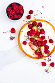 A berry tart with raspberries and strawberries