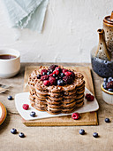 Chocolate waffles with forest fruits and honey