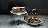 Panforte on a cake stand with cake tongs