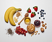 Various breakfast ingredients on a white surface