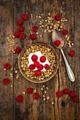 Granola with yoghurt and raspberries