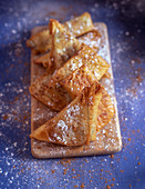 Puff pastry turnovers with cinnamon and icing sugar