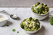 Pasta shells with basil pesto and roasted broccoli florets and grated parmesan