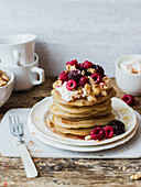 Greek pancakes with yogurt, raspberries, blackberries, walnuts and honey