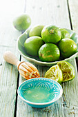 Lime juice, fresh limes and a juicer
