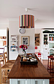 Striped ceiling lamp in open-plan country-house-style interior