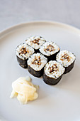Vegan maki sushi with shiitake mushrooms and pickled ginger