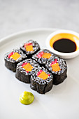 Vegan maki sushi with black rice, sweet potato and pink ginger