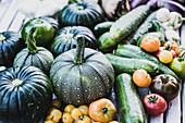 Freshly harvested tomatoes, round squash, cucumber, patty pan squash and aubergines