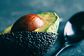 Sliced avocado on dark background