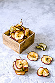 Dried apple chips in a wooden box