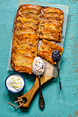 Caramelized pumpkin cake with mozzarella, whipped cream and icing sugar