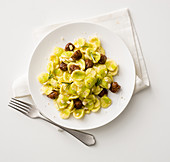 Orecchiette with savoy cabbage, sausage meat and almonds