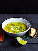 Red lentil soup with yoghurt and coriander