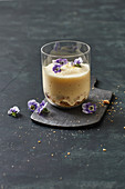 Berlin cheesecake in a glass with lemon salt and tufted pansies