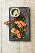 Warm salmon sashimi with broccoli and a wasabi and cucumber salad