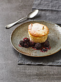 Almond-quark souffle with flambéed blackberries