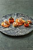 Three variations of pumpkin: piccata, chutney and mayonnaise