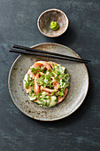 Marinated wild salmon with creamy wasabi cucumbers and passion fruit vinaigrette