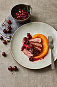 Fried duck breast with butternut squash and cherries