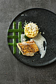 Zander with mustard sauce, courgette lattice and tender wheat risotto