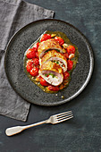 Stuffed piccata with warm oven-roasted tomatoes