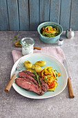 Flank steak on a bed of vegetable spirals with rosemary potatoes