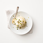 Poached spiced quince with mascarpone and Calvados cream, and pistachio nuts