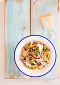 Cold pasta salad with onion and cheese