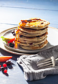 Pancakes with red fruit and banana