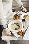 Jerusalem artichoke soup with pomegranate seeds and kale