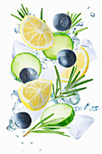Lemon, cucumber, blueberry and rosemary flying with ices and water splash
