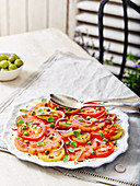 Tomato and Onion Salad With Capers Served with Olives
