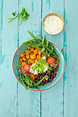 Cuba bowl with quinoa, beans, tomatoes, rocket and a coriander dip