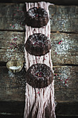 Chocolate mini bundt cakes with a dusting of powder
