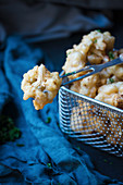 Deep-fried cauliflower in beer batter (vegan)