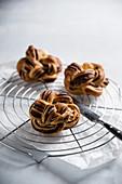 Vegan chocolate rolls on a wire rack
