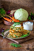 Cabbage and carrot fritters with dip