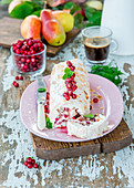 Cranberry and alomnd meringue roll with pears and cream