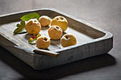 Quinces in a flat wooden dish